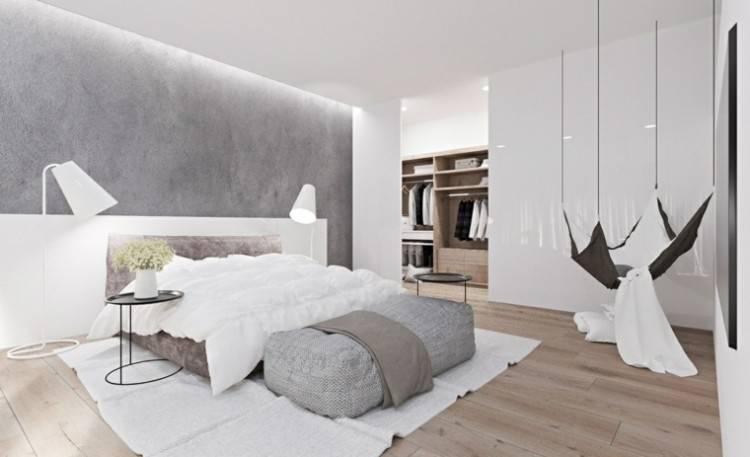 Blanc et gris moderne chambre à coucher avec lit double confortable, mur de brique, plancher en bois et grande fenêtre, architecture minimaliste scandinave