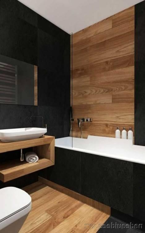 Baignoire blanche dans un intérieur blanc et noir salle de bain moderne carrelée avec un sol en béton