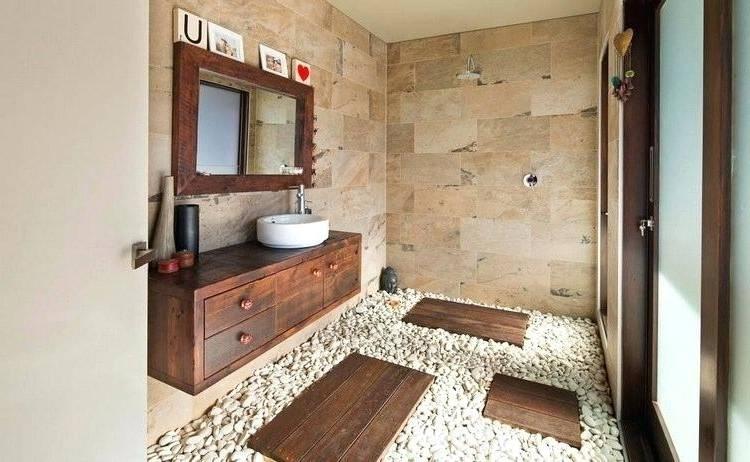 Au sol: galet  blanc et dans la douche de l'ardoise noire